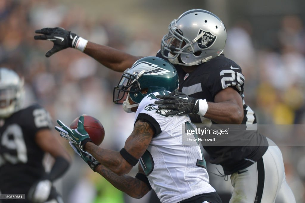DeSean Jackson of the Philadelphia Eagles catches a pass against DJ Hayden of the Oakland Raiders at Oco Coliseum on November 3 2013 in Oakland...