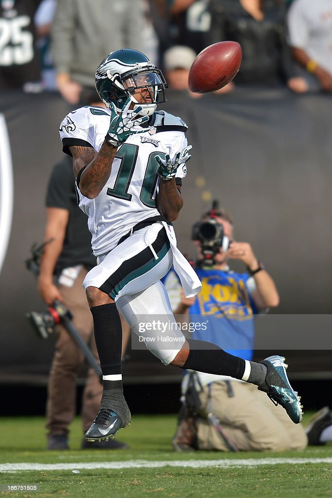 <a gi-track='captionPersonalityLinkClicked' href=/galleries/search?phrase=DeSean+Jackson&family=editorial&specificpeople=2212775 ng-click='$event.stopPropagation()'>DeSean Jackson</a> #10 of the Philadelphia Eagles catches a pass for a touchdown against the Oakland Raiders at O.co Coliseum on November 3, 2013 in Oakland, California. The Eagles won 49-20.