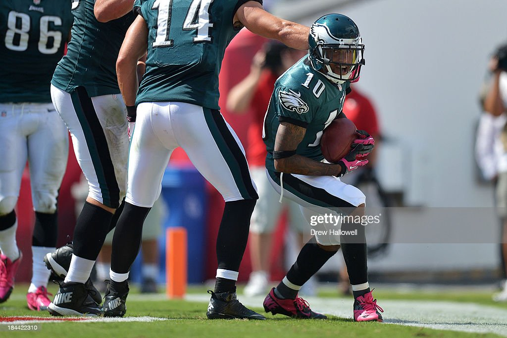 <a gi-track='captionPersonalityLinkClicked' href=/galleries/search?phrase=DeSean+Jackson&family=editorial&specificpeople=2212775 ng-click='$event.stopPropagation()'>DeSean Jackson</a> #10 of the Philadelphia Eagles celebrates a touchdown against the Tampa Bay Buccaneers at Raymond James Stadium on October 13, 2013 in Tampa, Florida. The Eagles won 30-21.