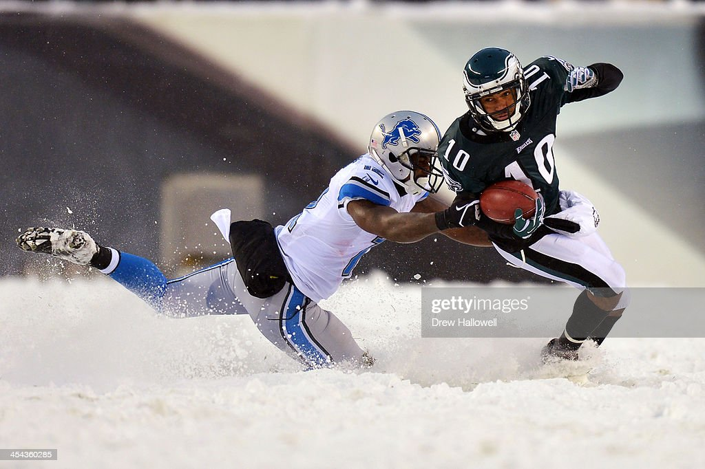 DeSean Jackson #10 of the Philadelphia Eagles gets pulled down by Jeremy Ross #12 of the Detroit Lions at Lincoln Financial Field on December 8, 2013 in Philadelphia, Pennsylvania. The Eagles won 34-20.