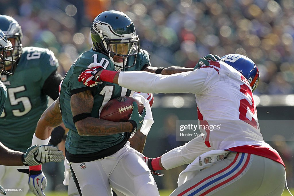 <a gi-track='captionPersonalityLinkClicked' href=/galleries/search?phrase=DeSean+Jackson&family=editorial&specificpeople=2212775 ng-click='$event.stopPropagation()'>DeSean Jackson</a> #10 of the Philadelphia Eagles runs after catching a pass during a game against the New York Giants on October 27, 2013 at Lincoln Financial Field in Philadelphia, Pennsylvania. The Giants won 15-7.