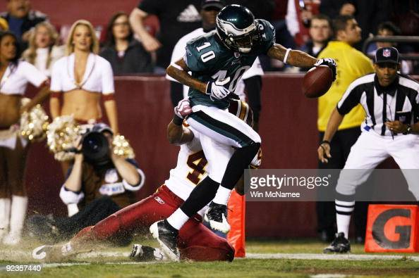 DeSean Jackson of the Philadelphia Eagles trips over Chris Horton of the Washington Redskins to score a touchdown in the second quarter of the game...