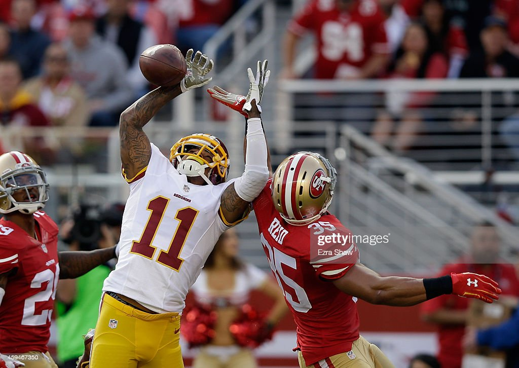 <a gi-track='captionPersonalityLinkClicked' href=/galleries/search?phrase=DeSean+Jackson&family=editorial&specificpeople=2212775 ng-click='$event.stopPropagation()'>DeSean Jackson</a> #11 of the Washington Redskins breaks up a pass intended for <a gi-track='captionPersonalityLinkClicked' href=/galleries/search?phrase=Jimmie+Ward+-+American+Football+Player&family=editorial&specificpeople=12685175 ng-click='$event.stopPropagation()'>Jimmie Ward</a> #25 of the San Francisco 49ers at Levi's Stadium on November 23, 2014 in Santa Clara, California.