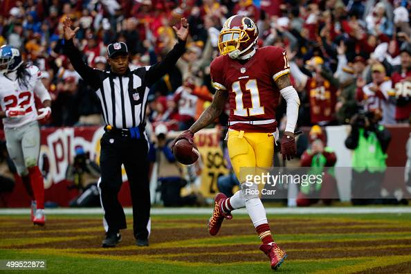 DeSean Jackson of the Washington Redskins dances into the end zone after catching a pass to score a touchdown against the New York Giants in the...