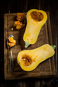 Deseeding a butternut squash, Cucurbita moschata, with a spoon