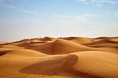 wind blowing on the desert dunes of Oman