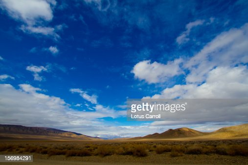 Desert hills with blue sky and white clouds : Stock Photo