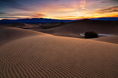 Waves of sand on top of the dunes. Sunrise. Desert in Mesquite Flat, Death Valley National Park, USA.