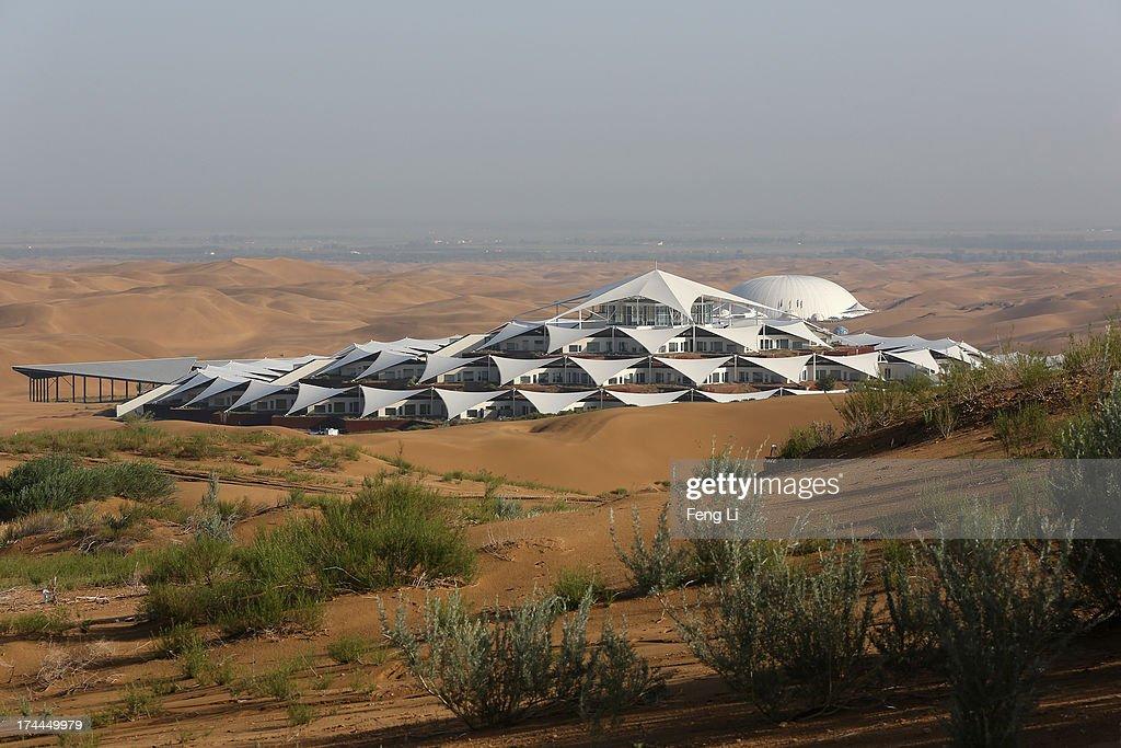 Desert Lotus Hotel under construction is seen in Xiangshawan Desert also called Sounding Sand Desert on July 19 2013 in Ordos of Inner Mongolia...