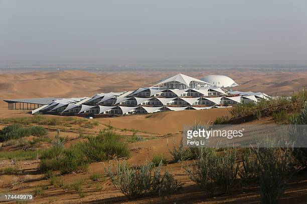 Desert Lotus Hotel under construction is seen in Xiangshawan Desert also called Sounding Sand Desert on July 19 2013 in Ordos of Inner Mongolia...