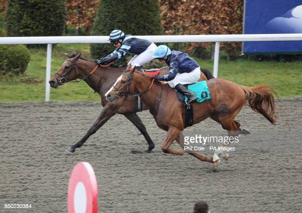 Desert Recluse ridden by Eddie Ahers holds off Buckland ridden by Nicole Nordblad to win the Betfred The Bonus King Queens Prize during the AWT...