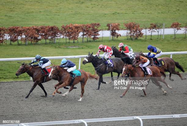 Desert Recluse ridden by Eddie Ahers nearest us holds off Buckland ridden by Nicole Nordblad to win the Betfred The Bonus King Queens Prize during...