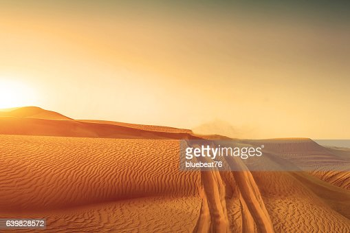 Desert sand dunes road at sunset : Stock Photo