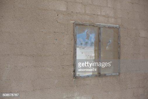 Desert view through a broken window, Dibba, UAE : Stock Photo