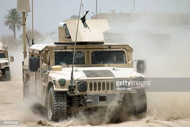Desert war armored tanks going through sandy terrain