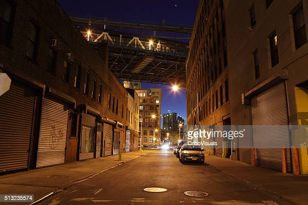 Deserted Brooklyn DUMBO back street under the bridges at night