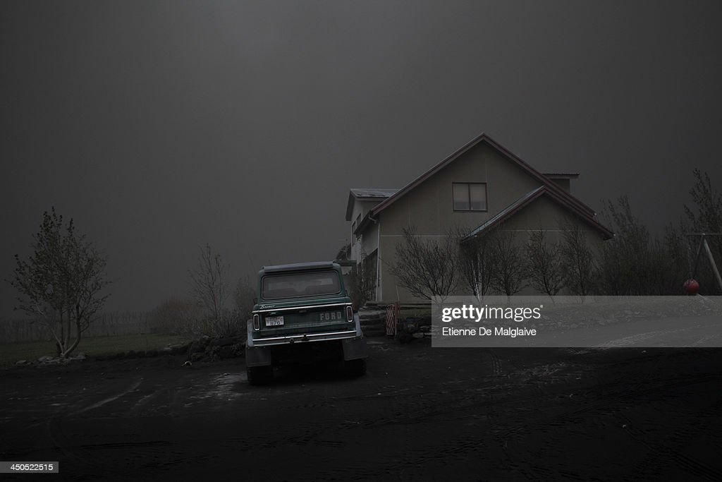 A deserted house under a dark fallout of ashes spewed by Iceland's Eyjafjallajokull volcano that blacked out visibility under the plume on May 13, 2010 near Reykjavik, Iceland.