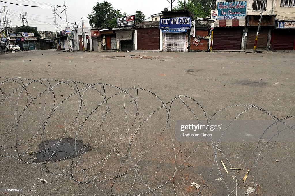 A deserted look of Jammu city during a curfew on August 13, 2013 in Jammu, India. Curfew continued in the eight districts of Jammu, Kathua, Samba, Reasi, Udhampur, Rajouri, Doda and Kishtwar districts of Jammu region. Loudspeaker-fitted police vehicles announced in the morning that curfew was in force in these districts and that people should remain indoors. While curfew continued for the fifth day in Kishtwar district where it was imposed on Friday following communal clashes, in other districts it continued for the fourth day on Tuesday. Police arrested 11 people in connection with the communal clashes in Kishtwar.