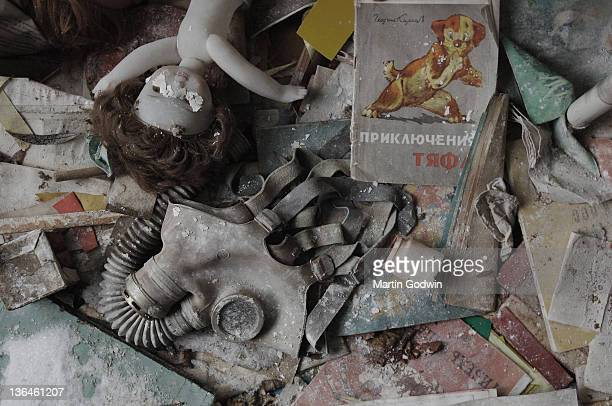 A deserted nursery school showing a broken doll books and gas mask in the abandoned town of Pripyat inside the Exclusion Zone around Chernobyl 20...