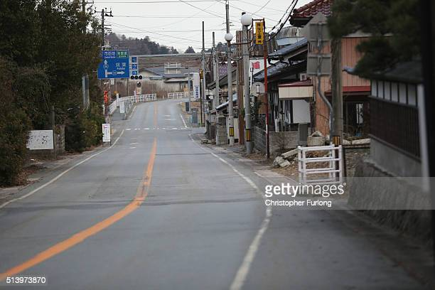A deserted street as vegetation and the elements begin to take their toll on homes and businesses inside the exclusion zone close to the devastated...