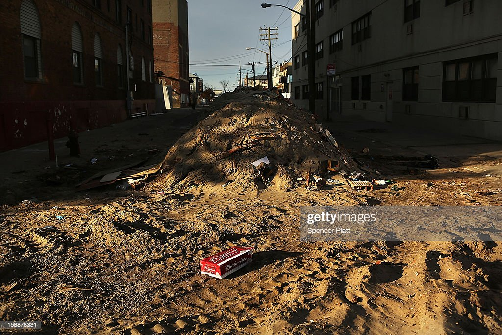 A deserted street is filled with sand along the beach in the Rockaways on January 2, 2013 in the Queens borough of New York City. Criticism, including by President Barack Obama, has been directed at the Republican House's decision to adjourn without passing a Superstorm Sandy aid bill. According to early estimates, Superstorm Sandy inflicted at least $50 to $60 billion in damage across the Northeast, making it one of the most destructive storms ever.