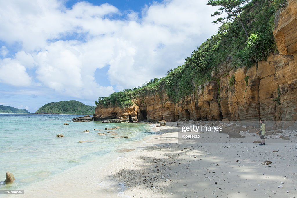 Deserted tropical beach with rock strata, Japan