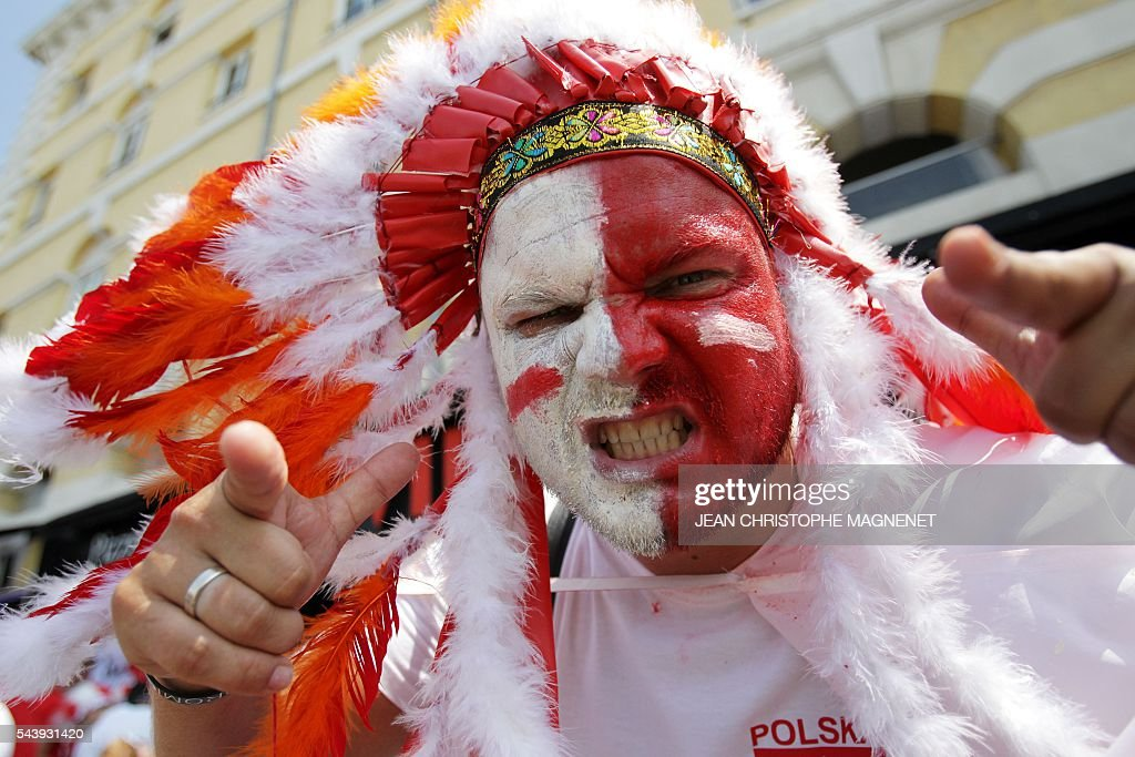 A desguised Poland supporter gestures as he cheers ahead of the Euro 2016 championship match between Poland and Portugal, in Marseille, southern France, on June 30, 2016. / AFP / JEAN