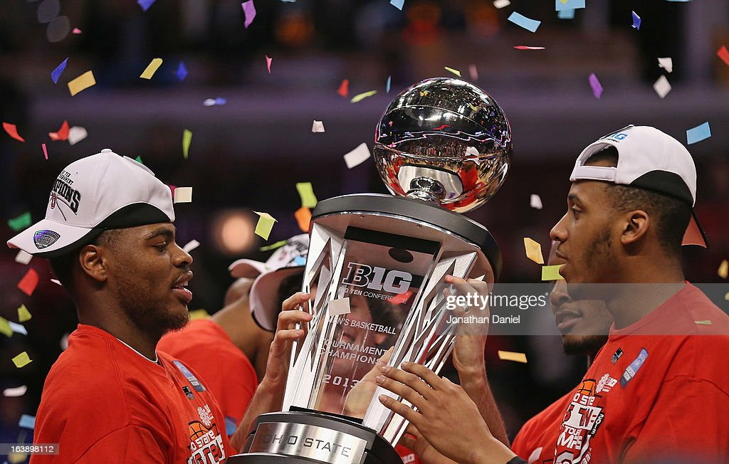 DeShaun Thomas #1 (L) and Amir Williams #23 of the Ohio State Buckeyes hold the trophy after the Buckeyes defeated the Wisconsin Badgers during the Big Ten Basketball Tournament Championship game at United Center on March 17, 2013 in Chicago, Illinois. Ohio State defeats Wisconsin 50-43.