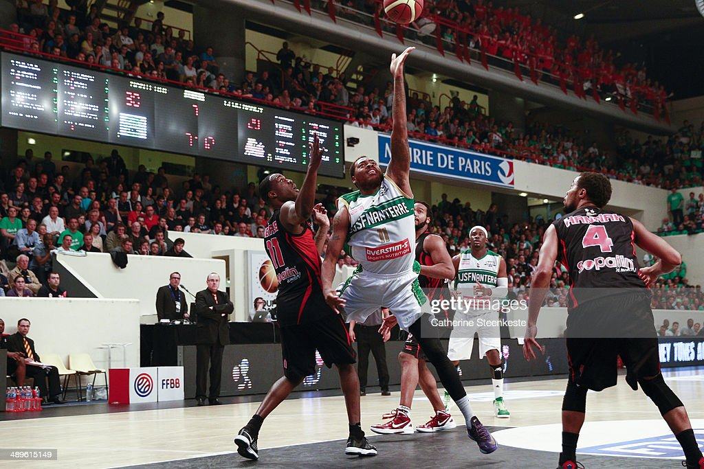 Deshaun Thomas of JSF Nanterre in action against Florent Pietrus of SLUC Nancy Basket Pro during the Final Cup game between JSF Nanterre and SLUC...