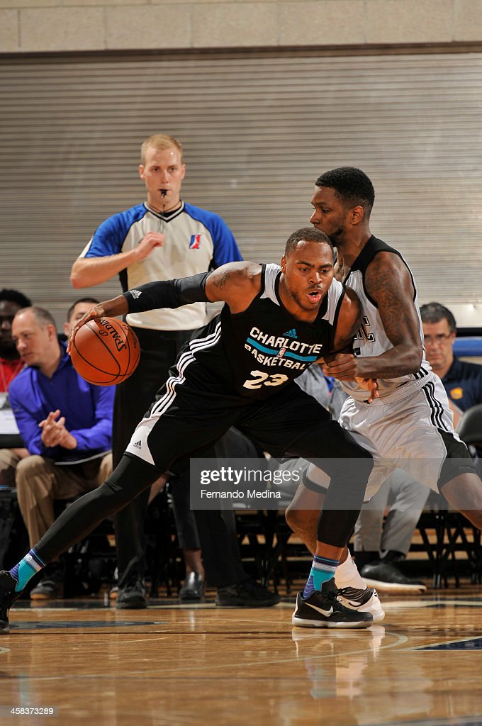 DeShaun Thomas of the Charlotte Hornets defends the ball against the Orlando Magic White during the 2016 Southwest Airlines Orlando Pro Summer League...