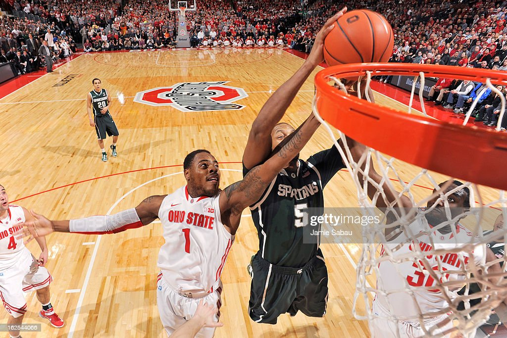 Deshaun Thomas #1 of the Ohio State Buckeyes and Evan Ravenel #30 of the Ohio State Buckeyes battle with Adreian Payne #5 of the Michigan State Spartans for a rebound in the first half on February 24, 2013 at Value City Arena in Columbus, Ohio. Ohio State defeated Michigan State 68-60.