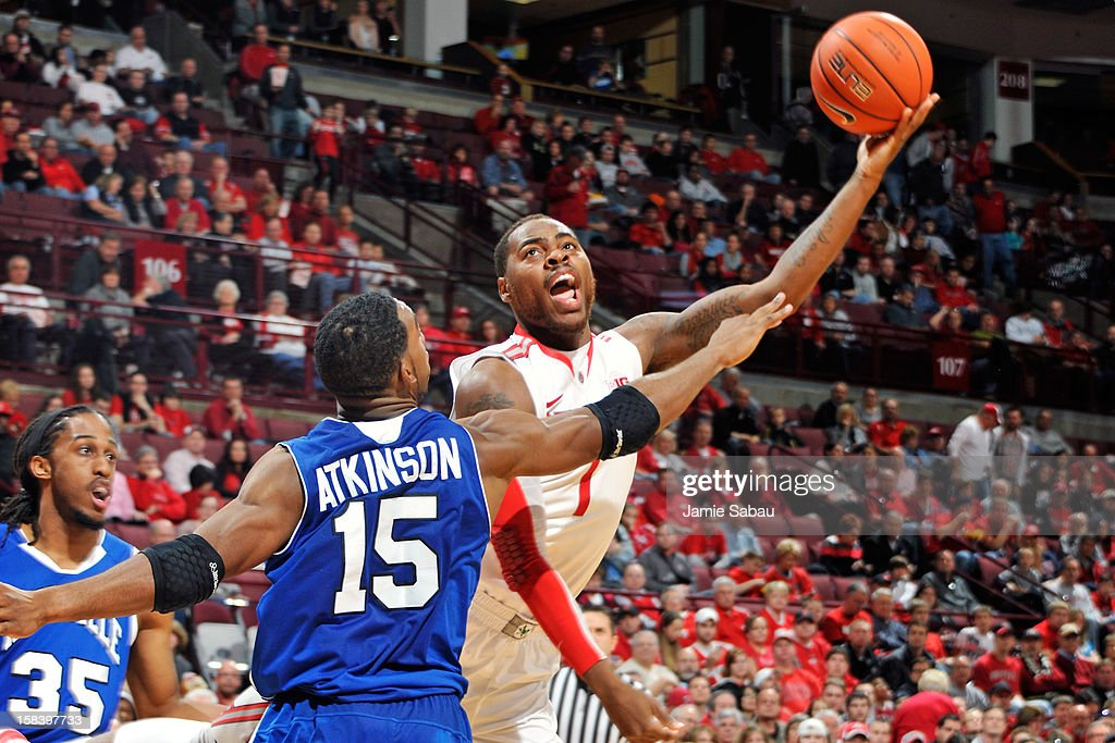 Deshaun Thomas #1 of the Ohio State Buckeyes attempts a shot as Jeremy Atkinson #15 of the UNC Asheville Bulldogs defends in the second half on December 15, 2012 at Value City Arena in Columbus, Ohio. Ohio State defeated UNC Asheville 90-72.