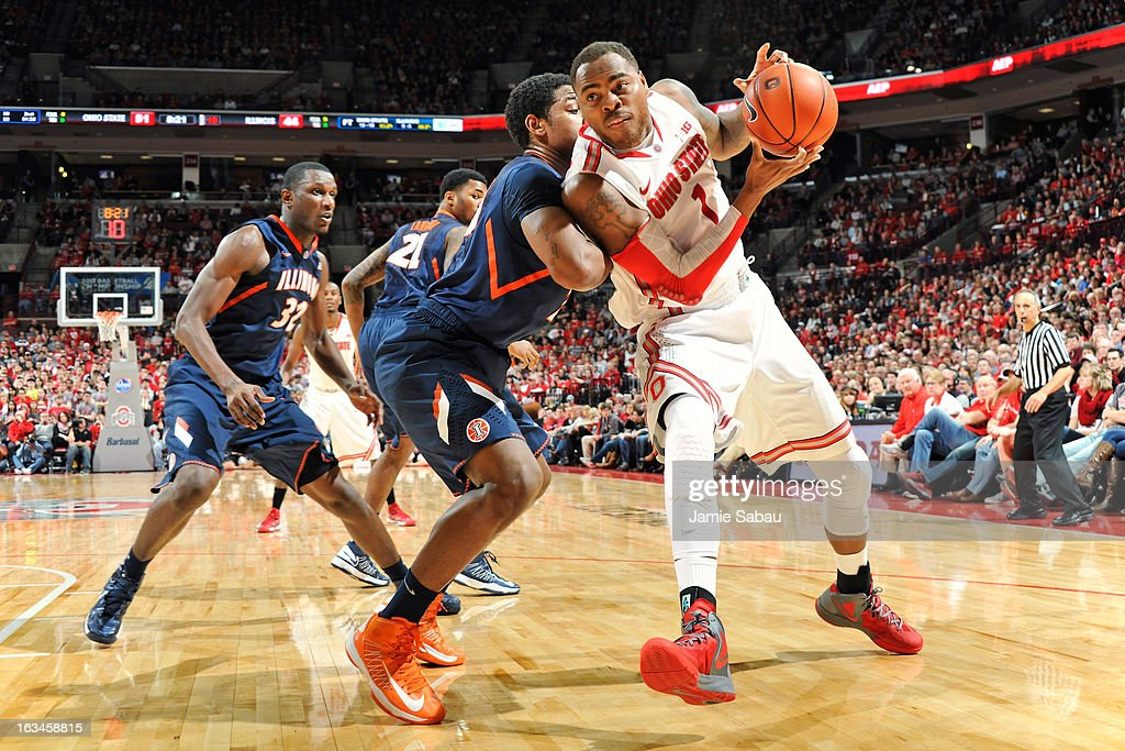 Deshaun Thomas #1 of the Ohio State Buckeyes attempts to drive the baseline against Myke Henry #20 of the Illinois Fighting Illini in the second half on March 10, 2013 at Value City Arena in Columbus, Ohio. Ohio State defeated Illinois 68-55.