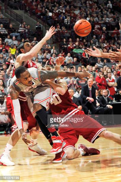 Deshaun Thomas of the Ohio State Buckeyes battles for control of a loose ball with Will Sheehey of the Indiana Hoosiers and Cody Zeller of the...