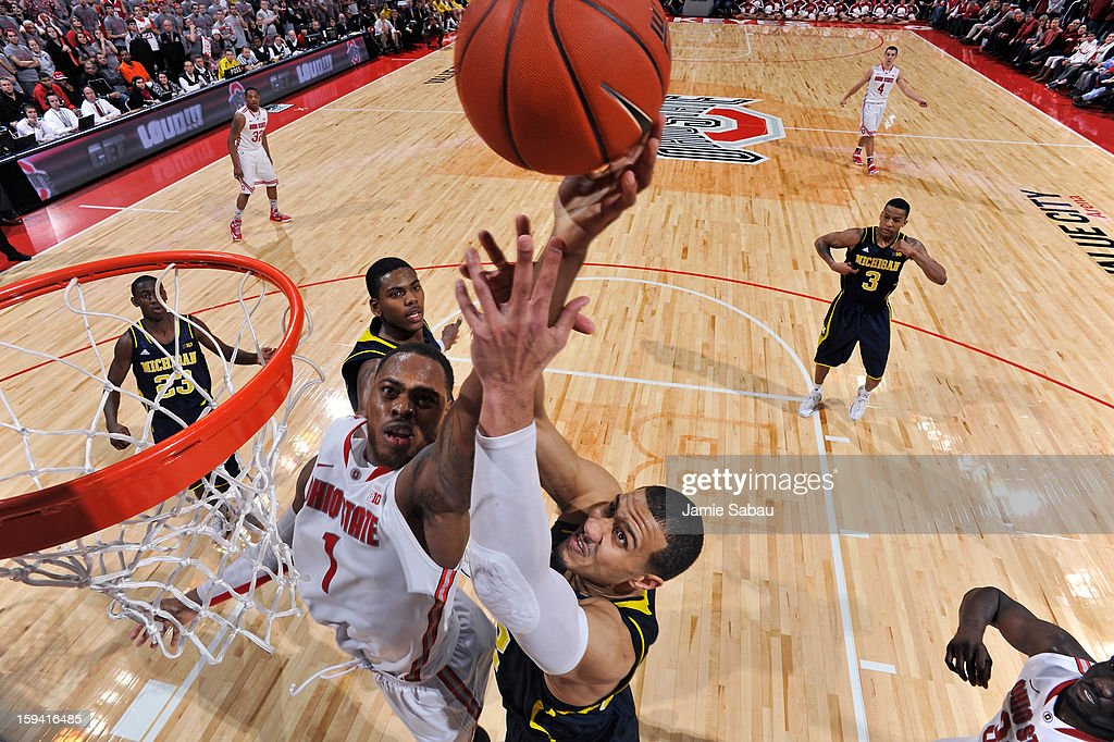 Deshaun Thomas #1 of the Ohio State Buckeyes battles Jordan Morgan #52 of the Michigan Wolverines for control of a rebound in the second half on January 13, 2013 at Value City Arena in Columbus, Ohio. Ohio State defeated Michigan 56-53.