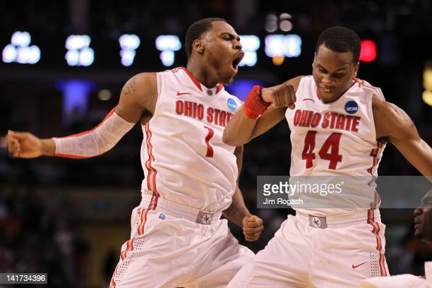 Deshaun Thomas of the Ohio State Buckeyes celebrates with teammate William Buford after a play against the Cincinnati Bearcats during their 2012 NCAA...