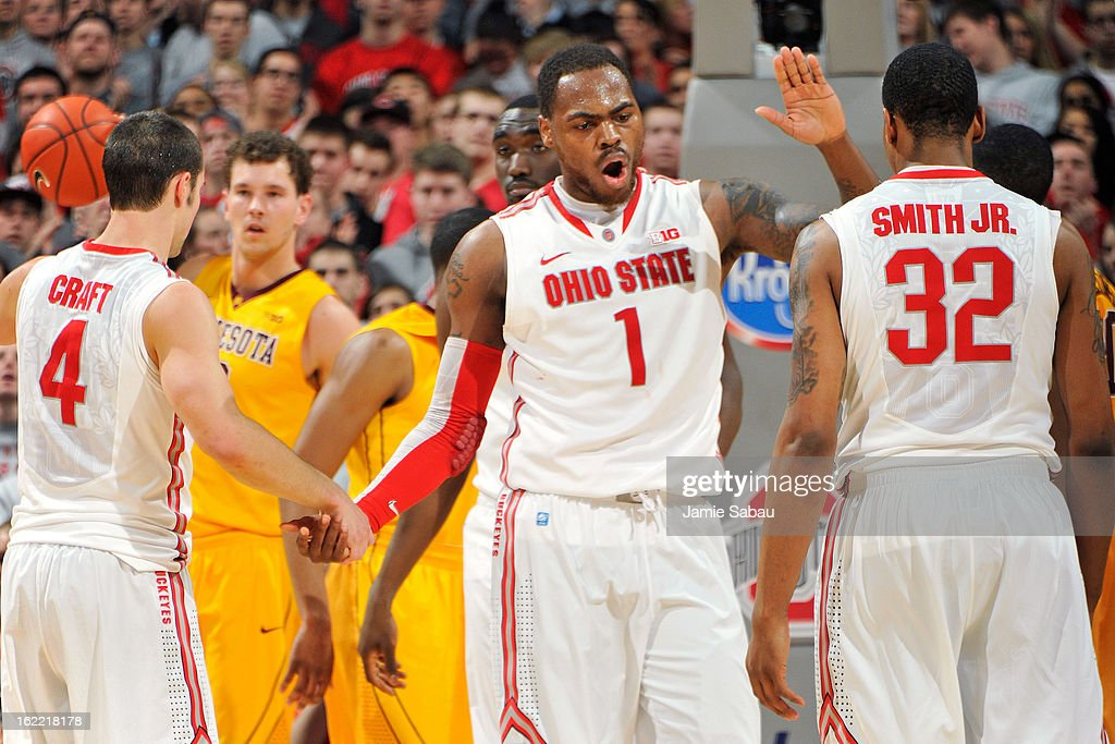 Deshaun Thomas #1 of the Ohio State Buckeyes celebrates with teammates <a gi-track='captionPersonalityLinkClicked' href=/galleries/search?phrase=Aaron+Craft&family=editorial&specificpeople=7348782 ng-click='$event.stopPropagation()'>Aaron Craft</a> #4 and Lenzelle Smith, Jr. #32 after making a basket against the Minnesota Golden Gophers in the first half on February 20, 2013 at Value City Arena in Columbus, Ohio. Ohio State defeated Minnesota 71-45.