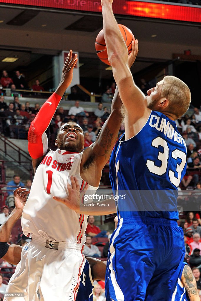 Deshaun Thomas #1 of the Ohio State Buckeyes drives to the basket as D.J. Cunningham #33 of the UNC Asheville Bulldogs defends in the second half on December 15, 2012 at Value City Arena in Columbus, Ohio. Ohio State defeated UNC Asheville 90-72.