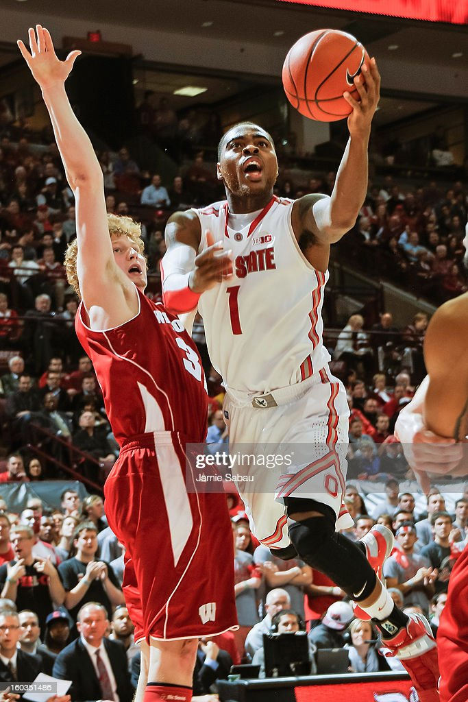 Deshaun Thomas #1 of the Ohio State Buckeyes drives to the basket to score two of his game-high 25 points past Mike Bruesewitz #31 of the Wisconsin Badgers in the second half on January 29, 2013 at Value City Arena in Columbus, Ohio. Ohio State defeated Wisconsin 58-49.