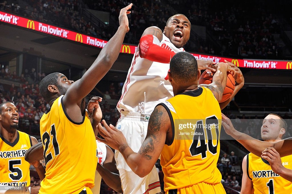 Deshaun Thomas of the Ohio State Buckeyes fights through the defense of Jalen Billups and Eshaunte Jones of the Northern Kentucky Norse to attempt a...