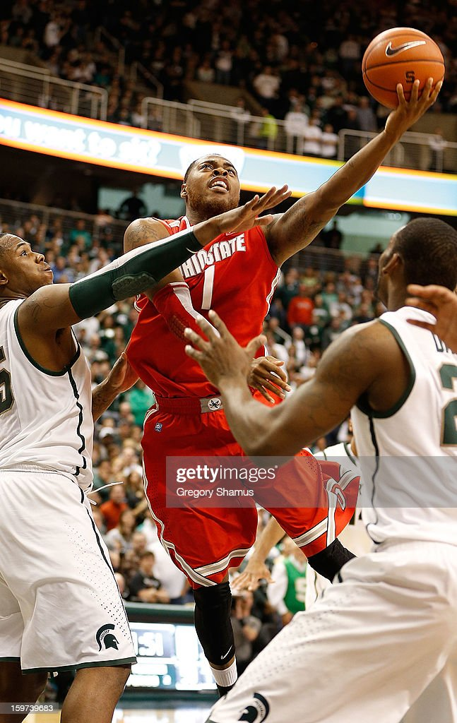 Deshaun Thomas #1 of the Ohio State Buckeyes gets a second-half shot gainst Derrick Nix #25 of the Michigan State Spartans at the Breslin Center on January 19, 2013 in East Lansing, Michigan. Michigan State won the game 59-56.