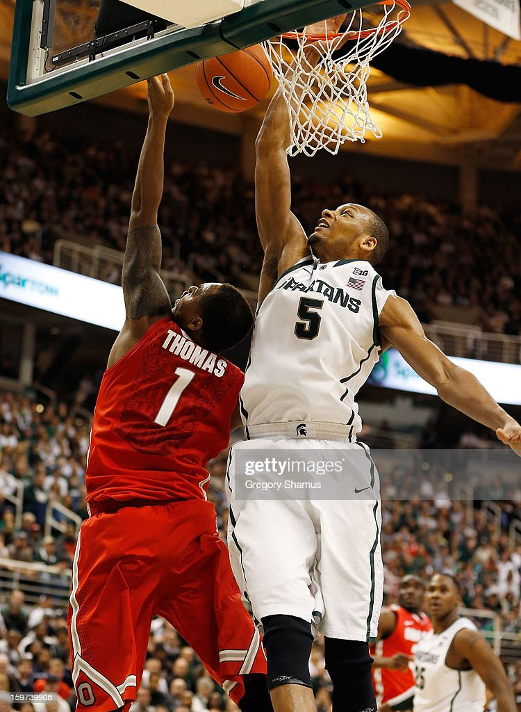 Deshaun Thomas #1 of the Ohio State Buckeyes gets his second-half shot blocked by Adreian Payne #5 of the Michigan State Spartans at the Jack Breslin Center on January 19, 2013 in East Lansing, Michigan. Michigan State won the game 59-56.