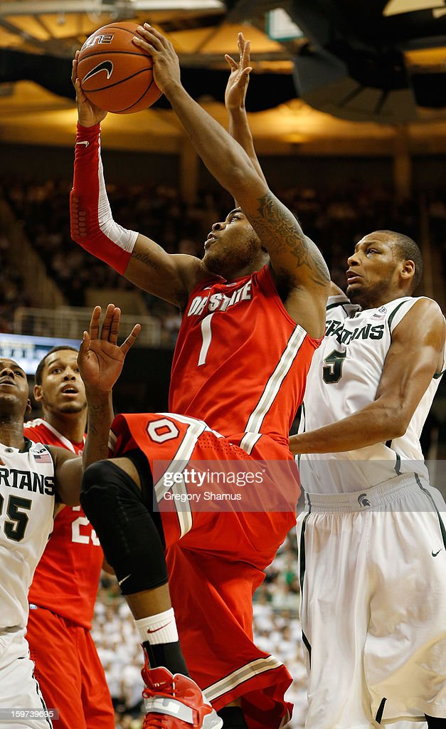 Deshaun Thomas #1 of the Ohio State Buckeyes gets to the basket for a second-half shot against Adreian Payne #5 of the Michigan State Spartans at the Jack Breslin Center on January 19, 2013 in East Lansing, Michigan. Michigan State won the game 59-56.
