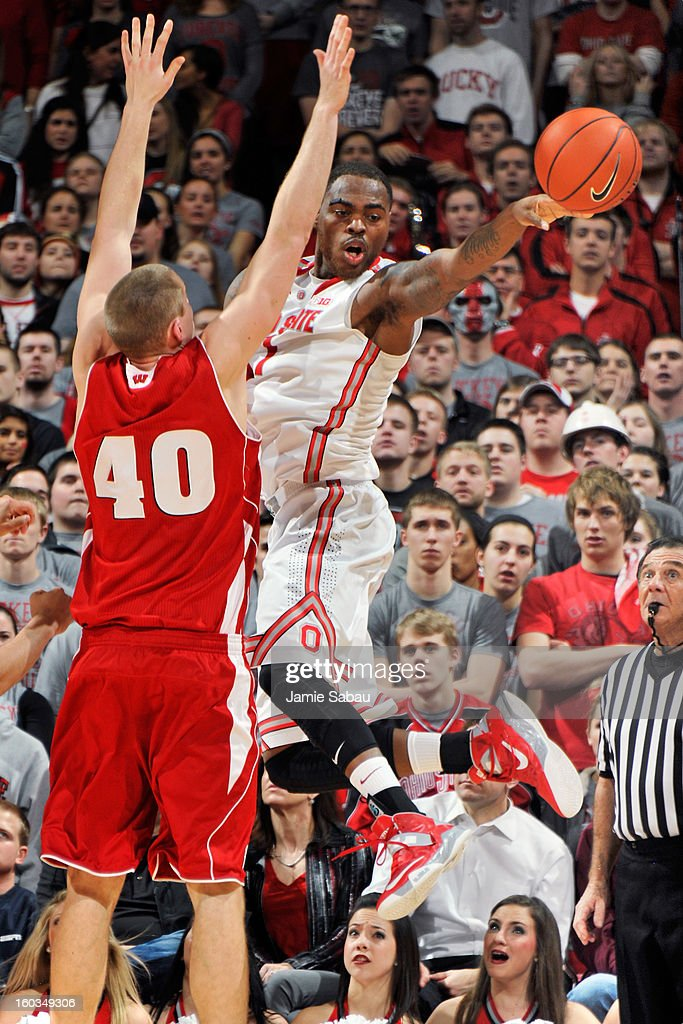 Deshaun Thomas #1 of the Ohio State Buckeyes passes off the ball as Jared Berggren #40 of the Wisconsin Badgers defends in the first half on January 29, 2013 at Value City Arena in Columbus, Ohio.