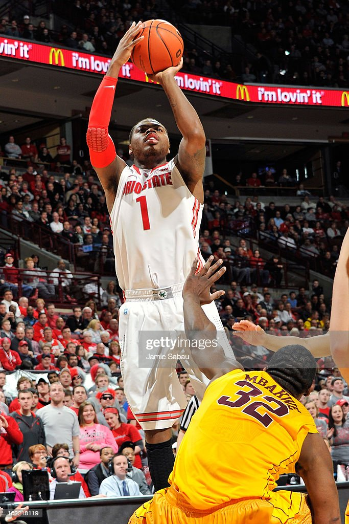 Deshaun Thomas #1 of the Ohio State Buckeyes puts up two of his game-high 19 points over <a gi-track='captionPersonalityLinkClicked' href=/galleries/search?phrase=Trevor+Mbakwe&family=editorial&specificpeople=4898343 ng-click='$event.stopPropagation()'>Trevor Mbakwe</a> #32 of the Minnesota Golden Gophers in the second half on February 20, 2013 at Value City Arena in Columbus, Ohio. Ohio State defeated Minnesota 71-45.
