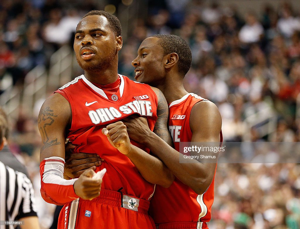 Deshaun Thomas #1 of the Ohio State Buckeyes reacts to a second-half play with Sam Thompson #12 at the Jack Breslin Center on January 19, 2013 in East Lansing, Michigan. Michigan State won the game 59-56.