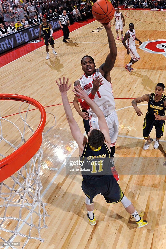 Deshaun Thomas #1 of the Ohio State Buckeyes shoots over Nik Stauskas #11 of the Michigan Wolverines in the second half for two of his game high 20 points on January 13, 2013 at Value City Arena in Columbus, Ohio. Ohio State defeated Michigan 56-53.