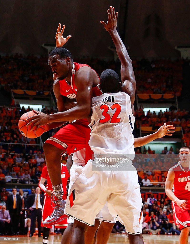 Deshaun Thomas #1 of the Ohio State Buckeyes tries to get off a shot as Nnanna Egwu #32 of the Illinois Fighting Illini applies tight defense at Assembly Hall on January 5, 2013 in Champaign, Illinois. Ilinois defeated Ohio State 74-55.