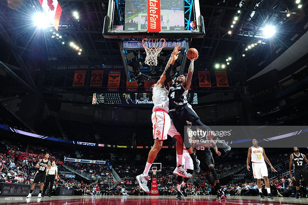 Deshaun Thomas of the San Antonio Spurs goes to the basket against the Atlanta Hawks on October 14 2015 at Philips Arena in Atlanta Georgia NOTE TO...