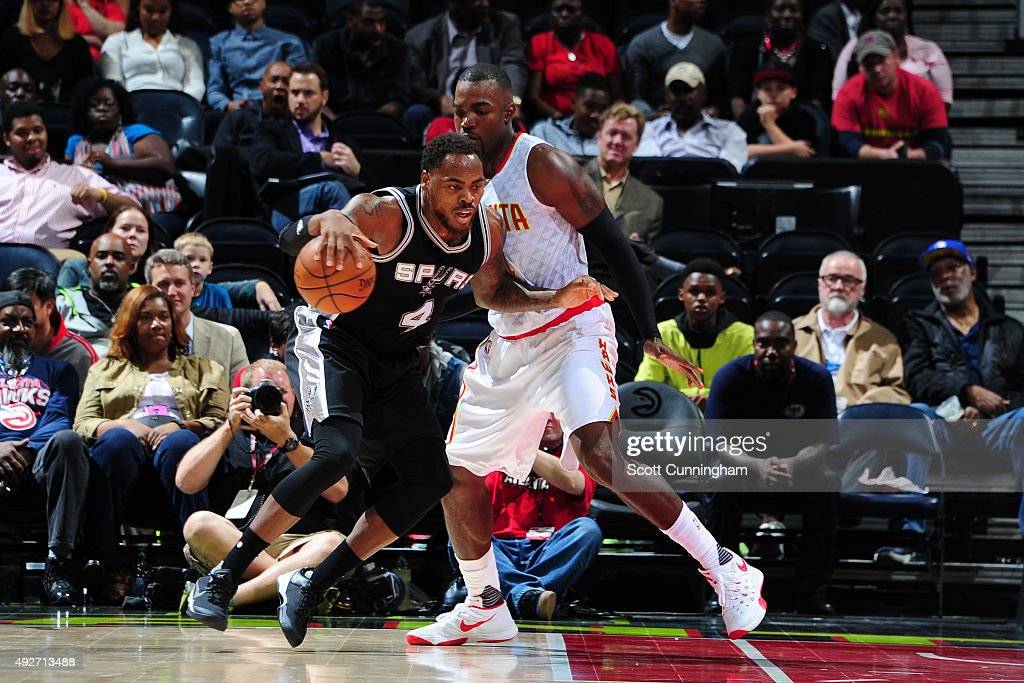 Deshaun Thomas #4 of the San Antonio Spurs handles the ball against the Atlanta Hawks on October 14, 2015 at Philips Arena in Atlanta, Georgia.